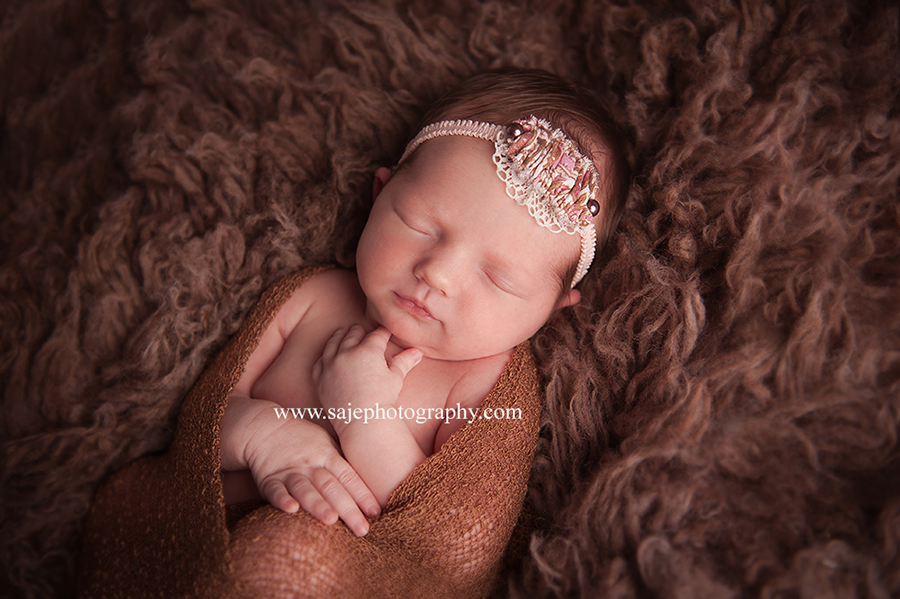 Saje photography is the face of hospital baby portraiture the face of beautiful in studio or in home newborn photography there is nothing that is more